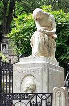 Chopin's tomb at P�re-Lachaise, Paris with Cl�singer's monument of a weeping woman (Jenny Lind, says Icons of Europe).