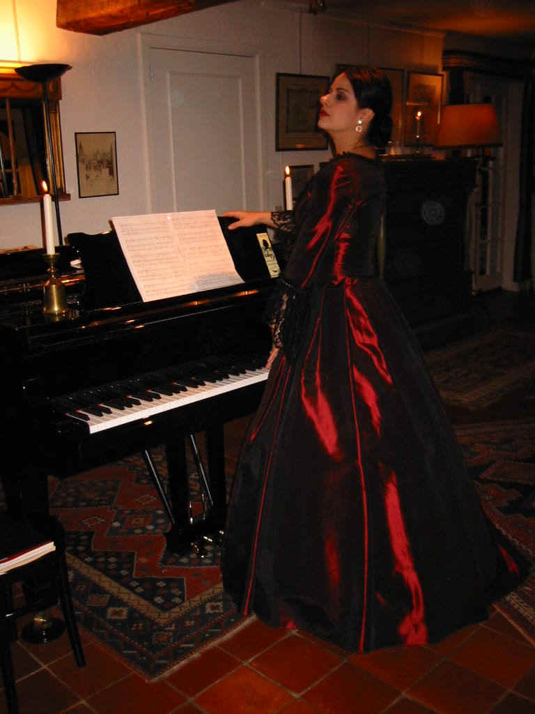 Act 5, Death:  Ljiljana Jovanovic standing at the piano singing and playing for Chopin as Delfina Potocka did on 15 October 1849.