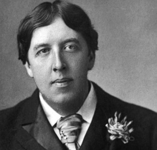 Oscar Wilde with a buttonhole decoration resembling a distinguished order.