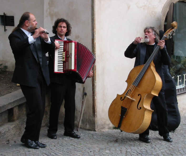 Prague is full of music - from the opera and the concert halls to the street.  A trio playing near the Château (April 2002).  Photo by Jens A. Jorgensen;  copyright  © 2002 Icons of Europe asbl.